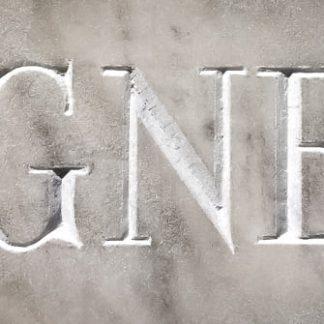 mot seigneur gravé dans le marbre au burin